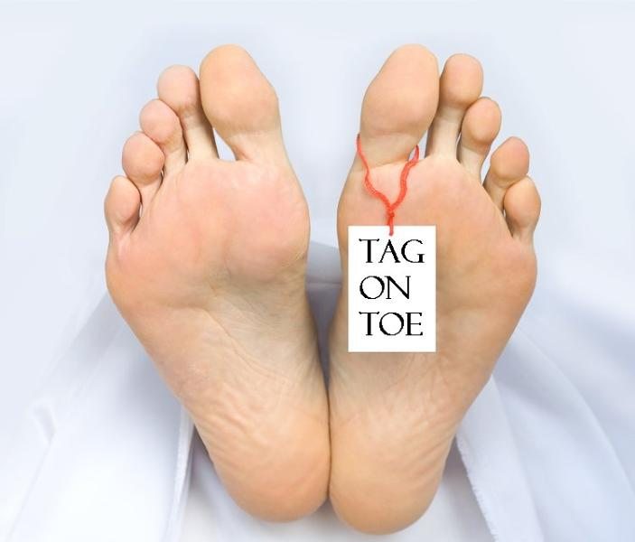 The bottoms of two bare feet with a tag